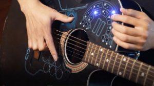 1043255-650-1450099122-black_guitar