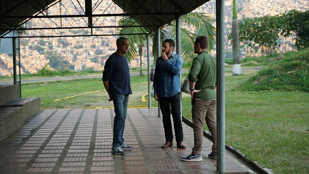 Joe Toft, Doug Laux, and Ben Smith have a chat underneath a covered patio in Medellin.