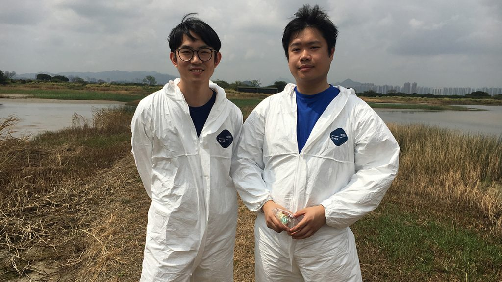 Researcher Don Wu and graduate student Sam Chan prepare to do surveillance at Mai Po Marsh.